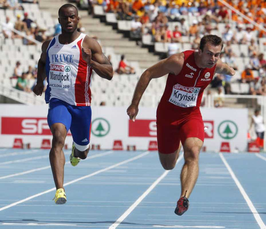 Poland's Krynski crosses the finish line ahead of France's Mbandjock during their men's 200 metres heats at the European Athletics Championships in Barcelona