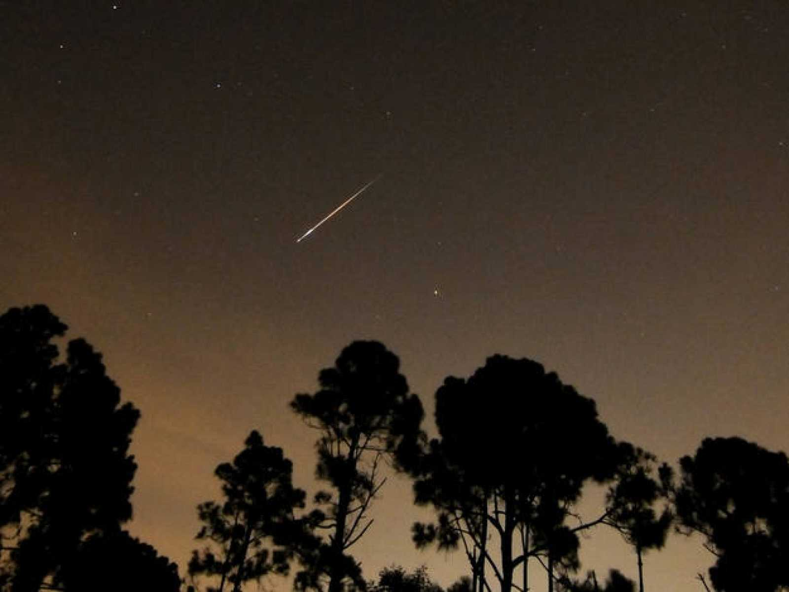 A Perseid meteor streaks towards the horizon during the annual Persied meteor shower in Palm Beach Gardens