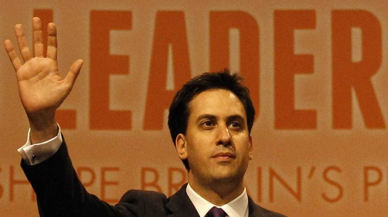 Former cabinet member Ed Miliband waves after being named the new leader of Britain's Labour Party at their annual conference in Manchester