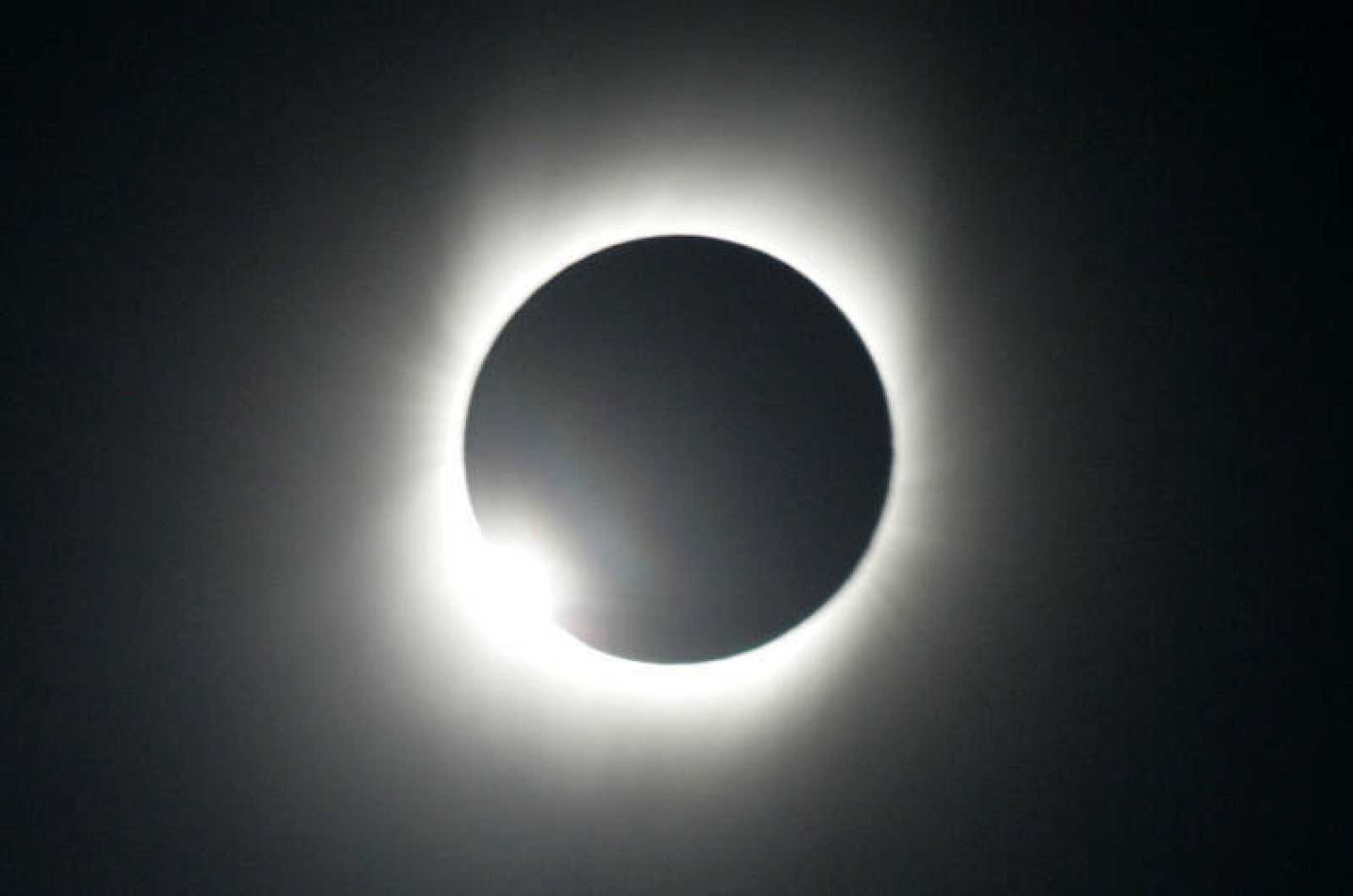 The moon passes between the sun and the earth during a total solar eclipse in Varanasi