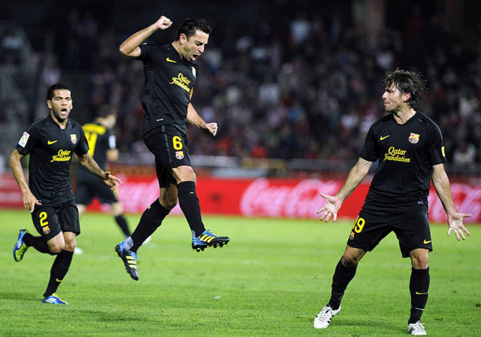 Xavi celebra su cuarto gol en Liga, frente al Granada.