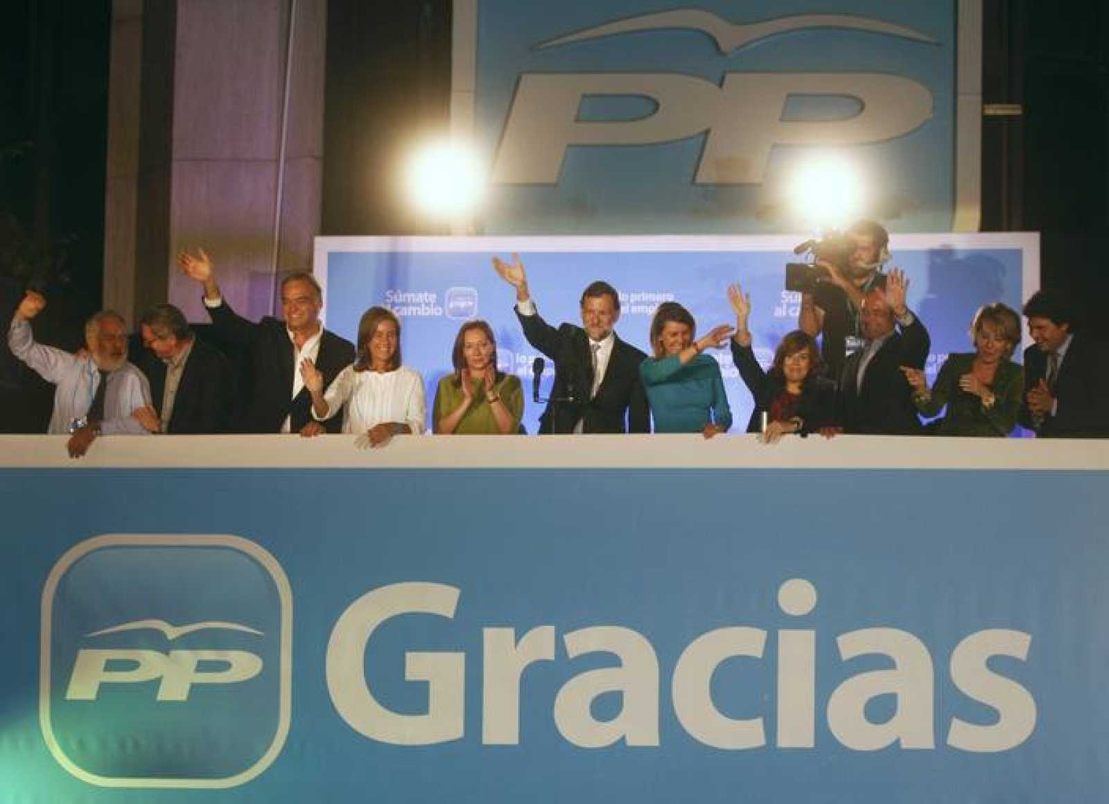 Spain's People's Party leader Rajoy acknowledges supporters next to his wife and members of his party after claiming victory in general elections in Madrid