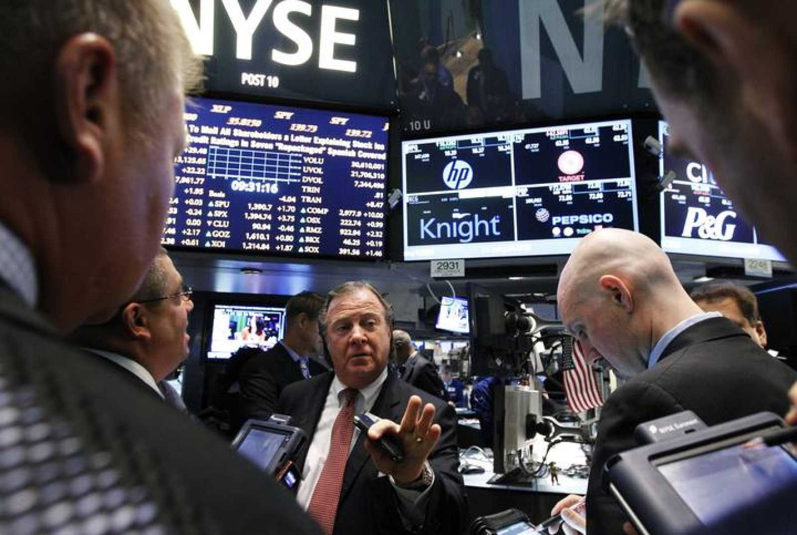 Traders gather at the Barclays Capital post that trades Knight Capital on the floor of the New York Stock Exchange