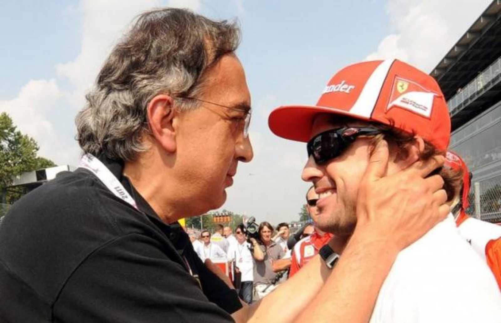Imagen de archivo del presidente de Ferrari, Sergio Marchionne, junto a Fernando Alonso.