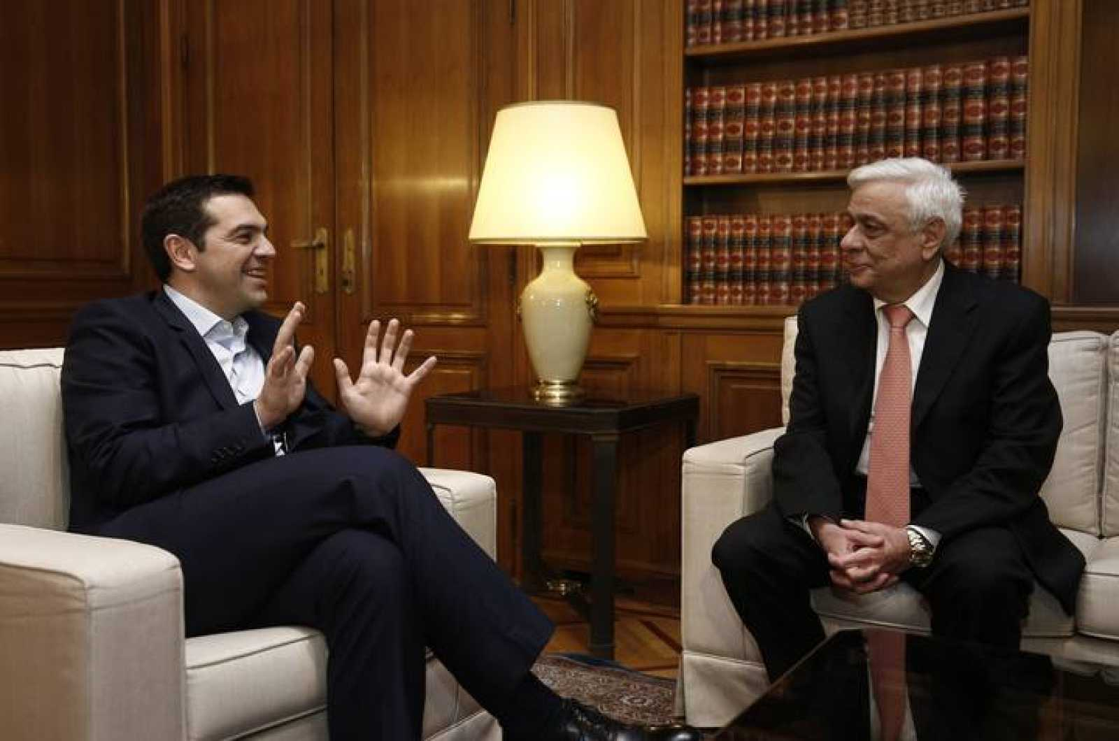Former Greek interior minister Prokopis Pavlopoulos and Greek Premier Tsipras meet  in Athens