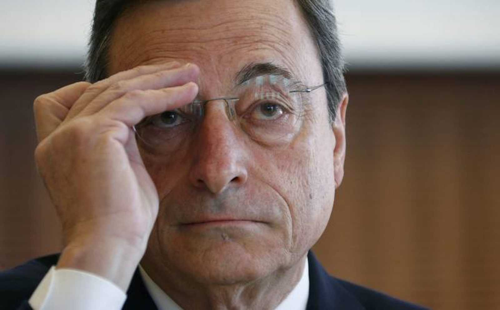 European Central Bank (ECB) President Draghi adjusts his glasses during the IMFS Conference 2015 in Frankfurt