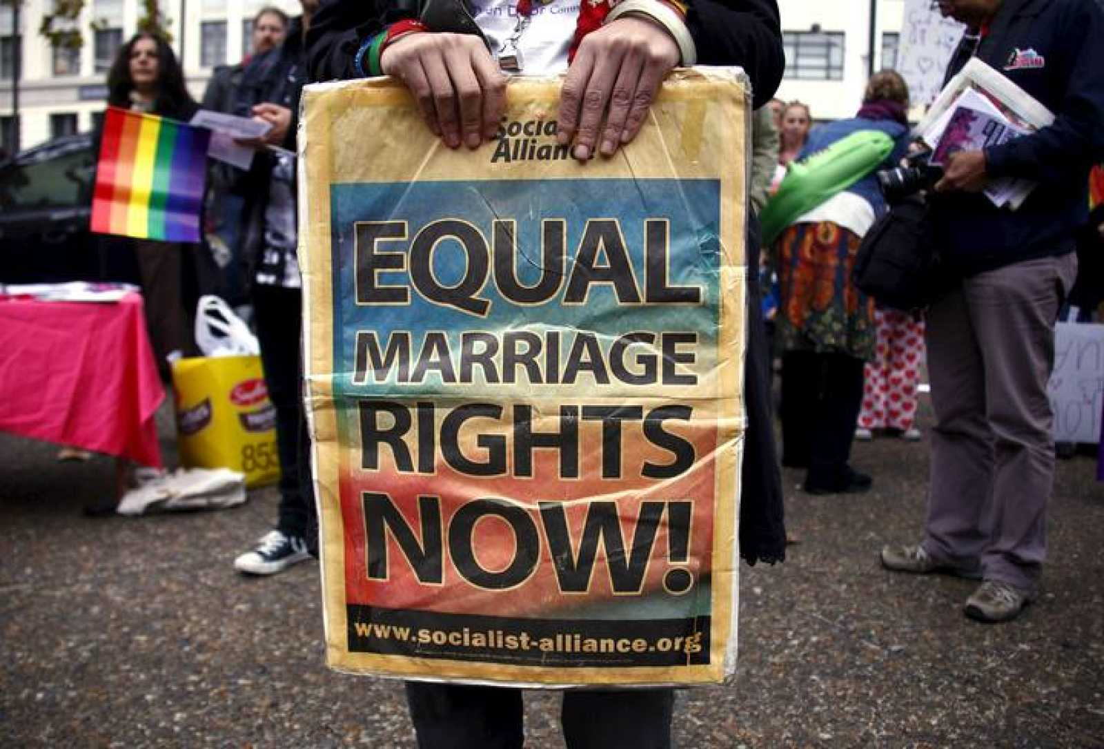 A gay rights activist holds a placard during a rally supporting same-sex marriage, in Sydney, Australia