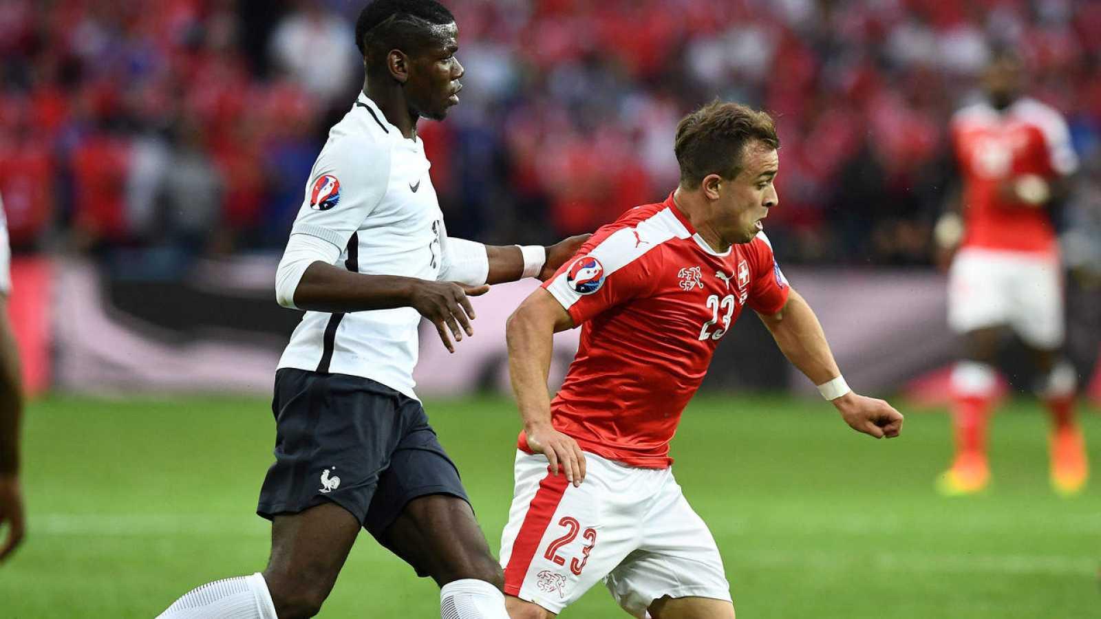 Pogba y Shaqiri, en el último partido del grupo A.