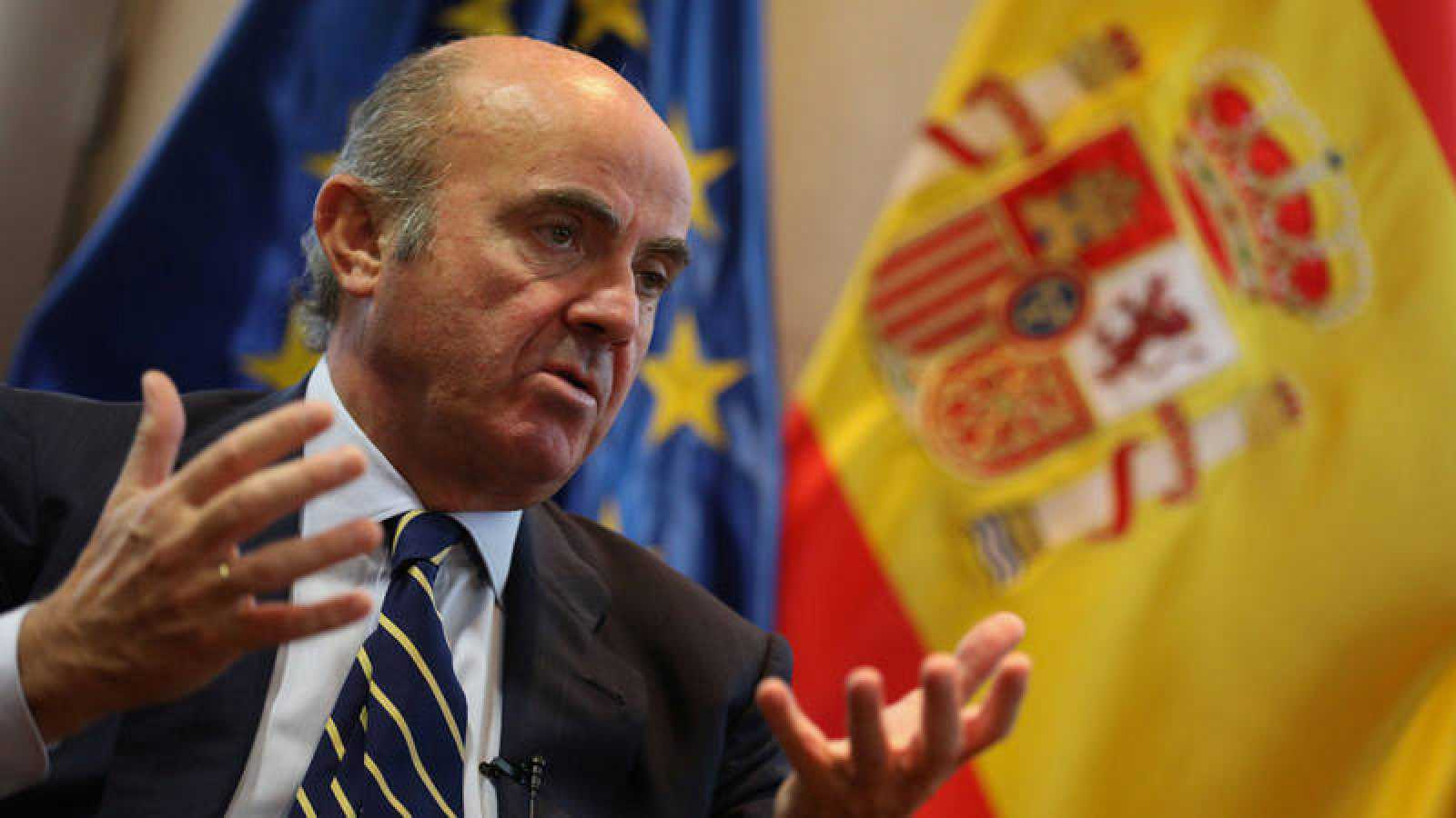 Spain's Economy Minister de Guindos gestures during an interview with Reuters at Economy Ministry in Madrid