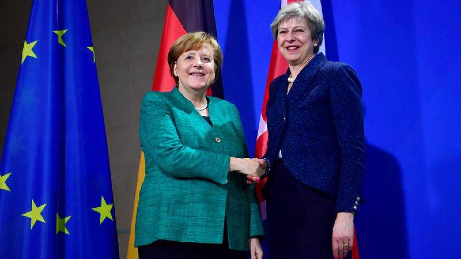 Angela Merkel y Theresa May, durante su encuentro en Berlín este viernes