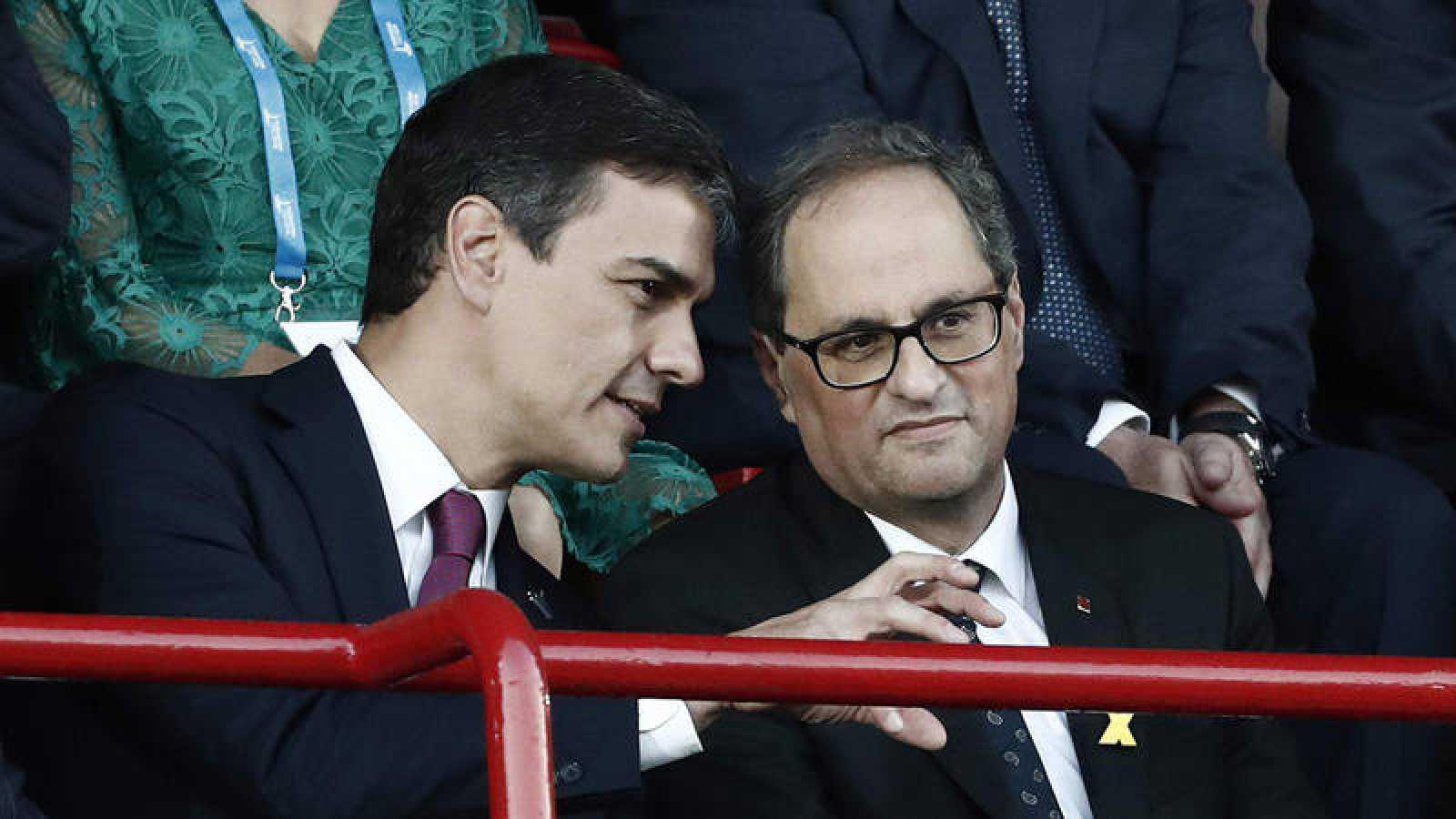 Pedro Sánchez y Quim Torra durante la inauguración de los XVIII Juegos Mediterráneos en Tarragona