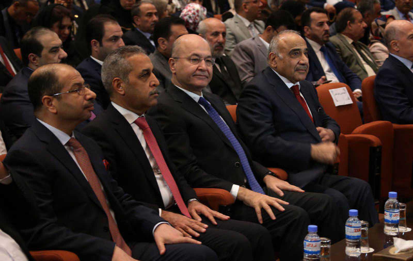 El presidente iraquí, Barham Saleh, y el nuevo primer ministro, Adel Abdulmahdi, en el Parlamento durante la votación del nuevo Gobierno