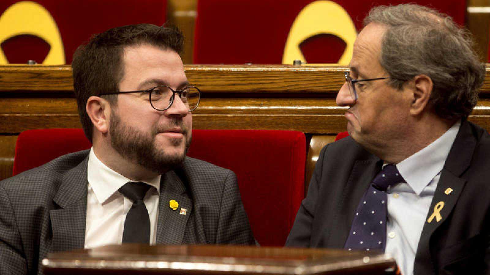 El presidente de la Generalitat, Quim Torra (d), y su vicepresidente, Pere Aragonés (i).