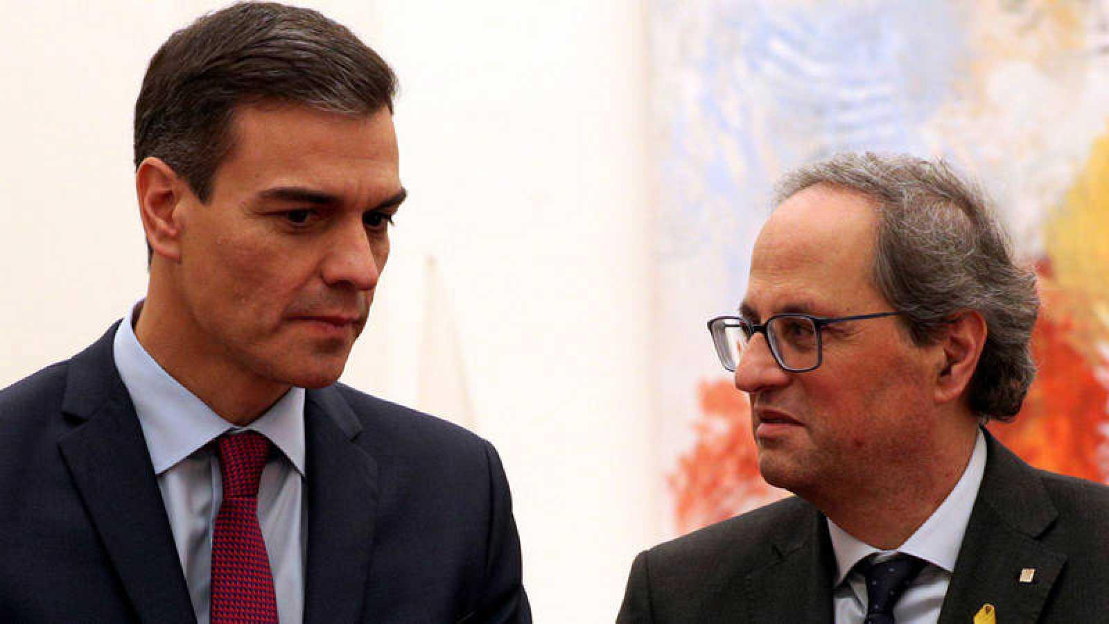 Pedro Sánchez y Quim Torra después de la reunión del pasado 20 de diciembre en Barcelona