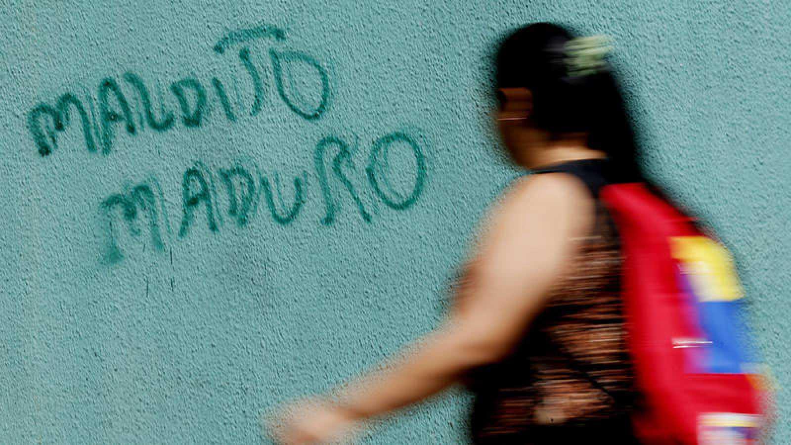 Fotografía del grafiti contra Maduro por el que fue detenido un cámara de Efe