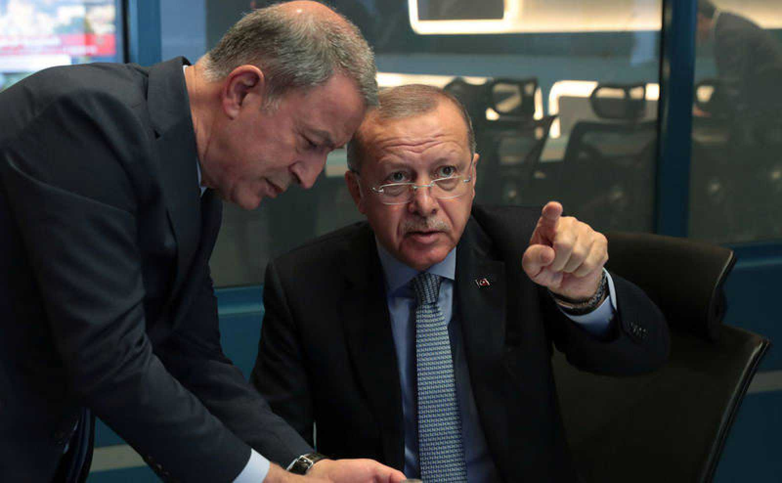 Turkish President Tayyip Erdogan is seen with Defence Minister Hulusi Akar at the operation center in Ankara, Turkey