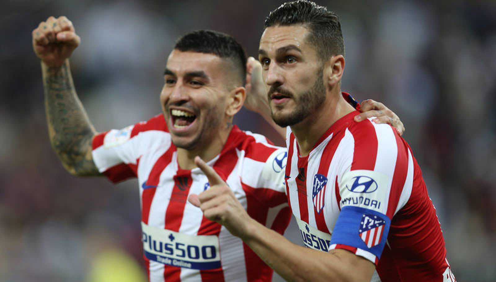 Correa y Koke celebran un gol del Atlético.