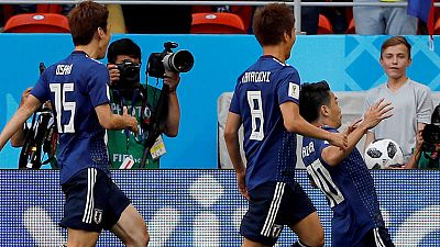 Los jugadores de Japón celebran el gol de Kagawa a Colombia.