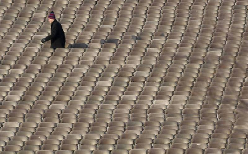 A man walks between chairs before the ticketed guests arrive for the inauguration of Obama in Washington
