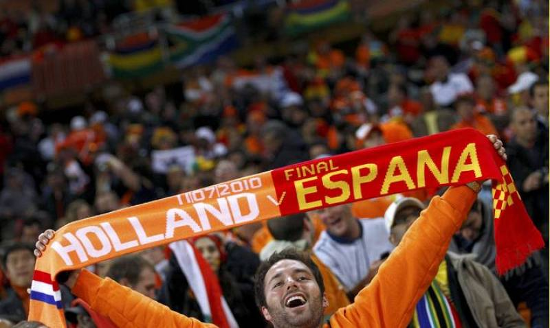 A fan holds up a scarf before the start of the 2010 World Cup final soccer match at Soccer City stadium