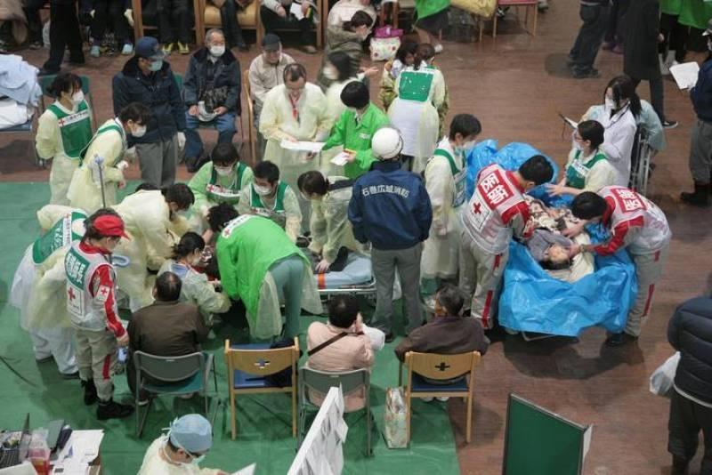 Survivors of an 8.9-magnitude earthquake and tsunami receive treatment at the Ishinomaki Red Cross hospital in Miyagi prefecture