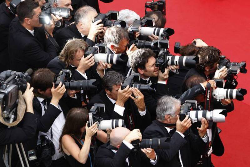 Press photographers take pictures ahead of the screening of the film Habemus Papam in competition at the 64th Cannes Film Festival