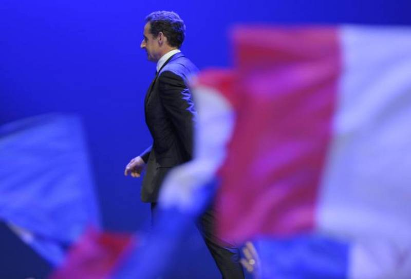 Nicolas Sarkozy, France's incumbent president, reacts after his defeat for re-election in the second round vote of the 2012 French presidential elections as he appears on stage before UMP party supporters at the Mutualite meeting hall in Paris