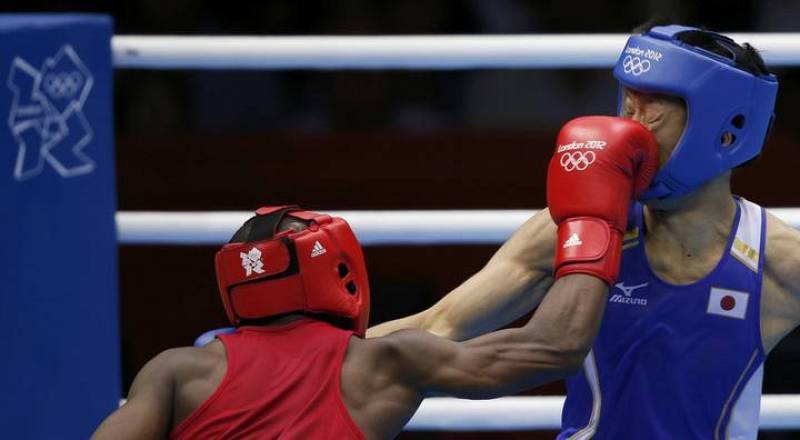 Ghana's Dogboe fights against Japan's Shimizu in the Men's Bantam (56kg) Round of 32 boxing match during the London 2012 Olympic Games