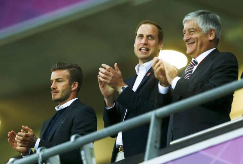Britain's Prince William, soccer ace David Beckham (L) and with Britain's Sports Minister Hugh Robertson watch the men's preliminary first round Group A soccer match between Britain and UAE at the London 2012 Olympic Games in the Wembley Stadium in L