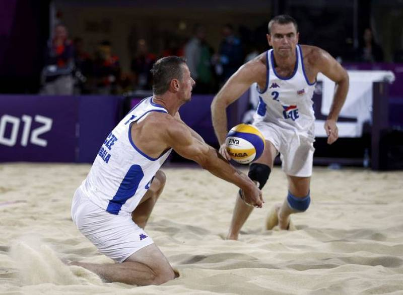 Czech Republic's Premysl Kubala digs the ball for Petr Benes against Todd Rogers and Phil Dalhausser of the U.S. during their men's preliminary round beach volleyball match at Horse Guards Parade during the London 2012 Olympic Games
