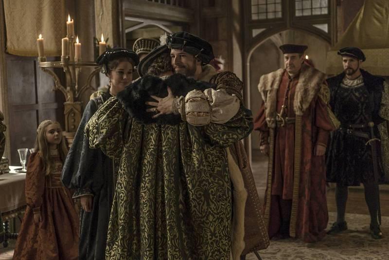 Carlos V abraza a sus hermanos Fernando y María