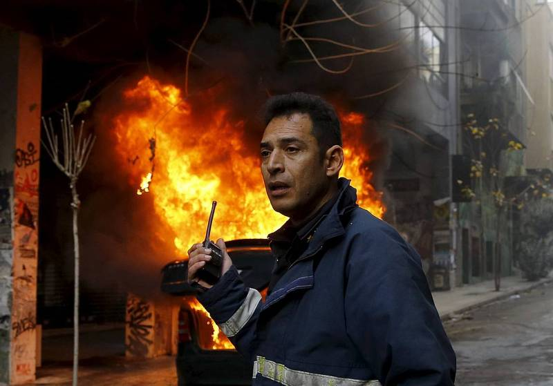 Fireman calls for help during a 24-hour general strike in central Athens,