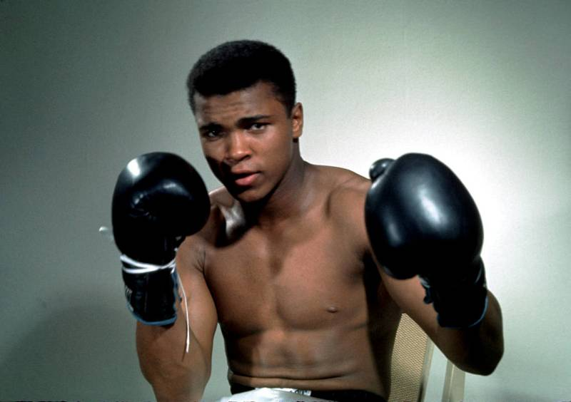 Muhammad Ali poses with gloves in this undated portrait.