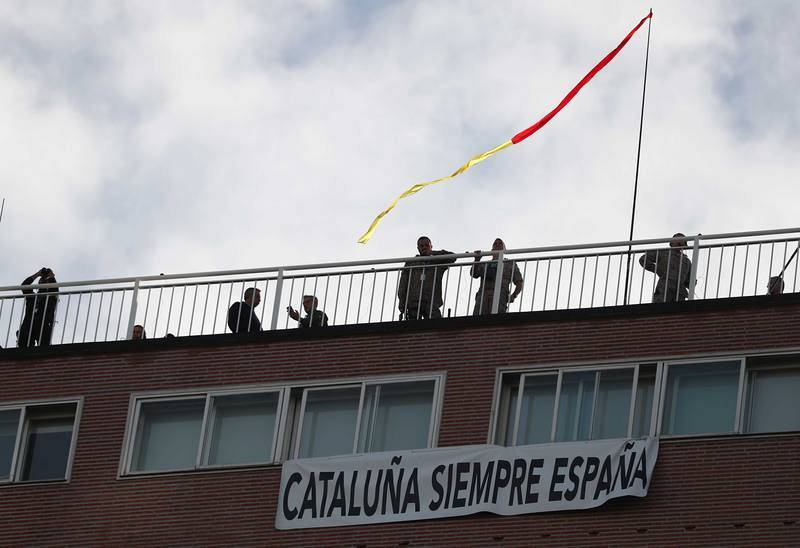 """A banner reading """"Catalonia Always Spain"""" hangs during a parade as part of celebrations to mark Spain's National Day in Madrid"""
