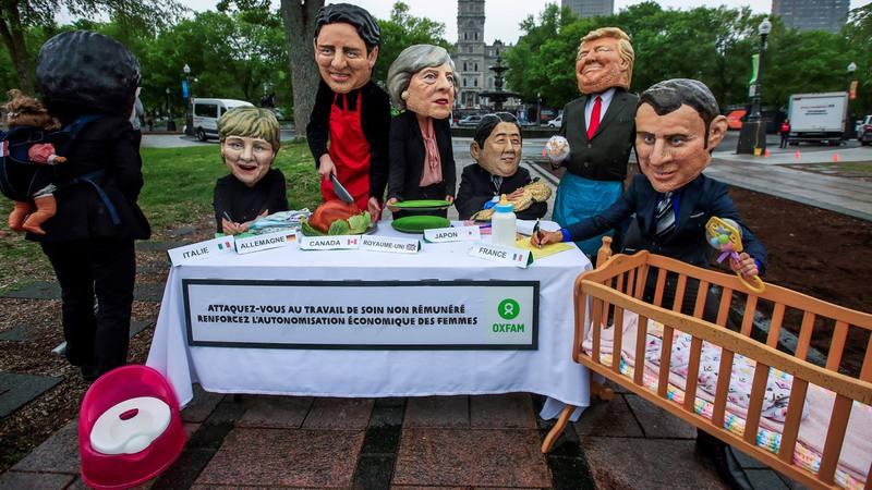 Activistas de Oxfam se disfrazan de los líderes del G7 para protestar contra la cumbre