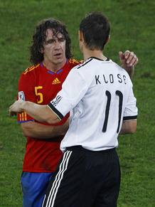 Spain's Puyol greets Germany's Klose at the end of their 2010 World Cup semi-final soccer match in Durban