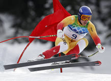 Canada's Erik Guay speeds down the course during the men's Alpine Skiing Downhill race of the Vancouver 2010 Winter Olympics in Whistler