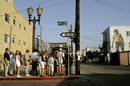 Tourists view mural of musician Jim Morrison near boardwalk as Venice Beach celebrates 100th year of ...