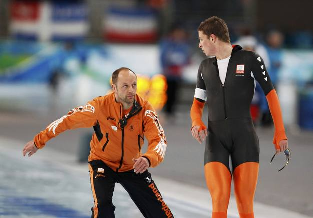 Kramer of the Netherlands looks at his coach Kemkers after finishing his race in the men's 10000 metres speed skating competition at the Vancouver 2010 Winter Olympics