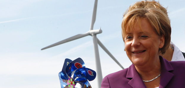 German Chancellor Merkel holds a windmill as she visits a wind turbine park 'WIND-projekt' in the northern German village of Ravensberg