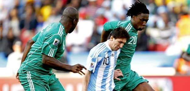 Argentina's Messi fights for the ball with Nigeria's Etuhu during a 2010 World Cup Group B soccer match at Ellis Park stadium in Johannesburg