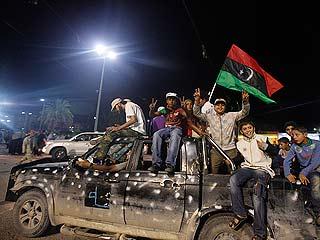 Miles de libios salen a las calles para celebrar la muerte de Gadafi