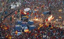 Crowds gather around the Spain's national soccer team during a celebration parade in downtown Madrid