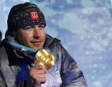 Gold medallist Miller poses during the medals ceremony for the men's super combined alpine skiing during the Vancouver 2010 Winter Olympics