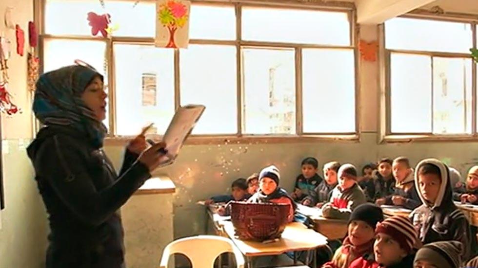 Los niños vuelven a la escuela en Alepo