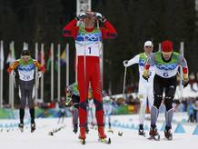 Norway's Northug celebrates as he crosses the finish line to win men's 50 km mass start classic cross-country final at Vancouver 2010 Winter Olympics in Whistler