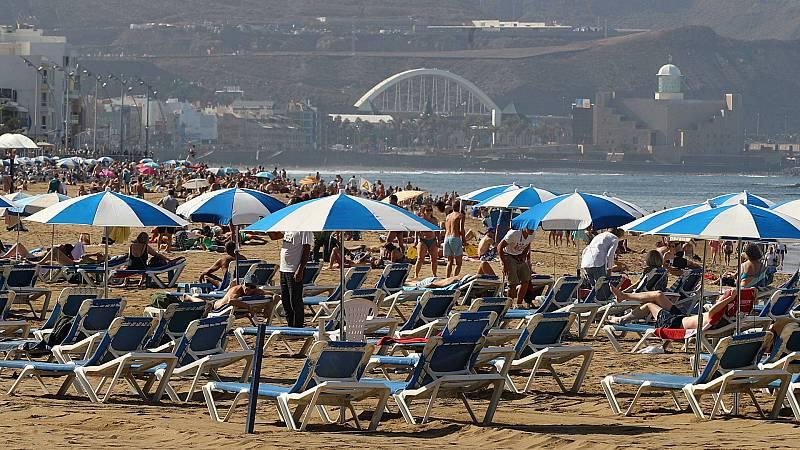 Boletines RNE - La llegada de turistas extranjeros sigue en cifras récord - Escuchar ahora