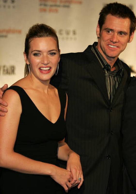 Cast members Kate Winslet and Jim Carrey pose at the DVD launch party for Eternal Sunshine of the ...