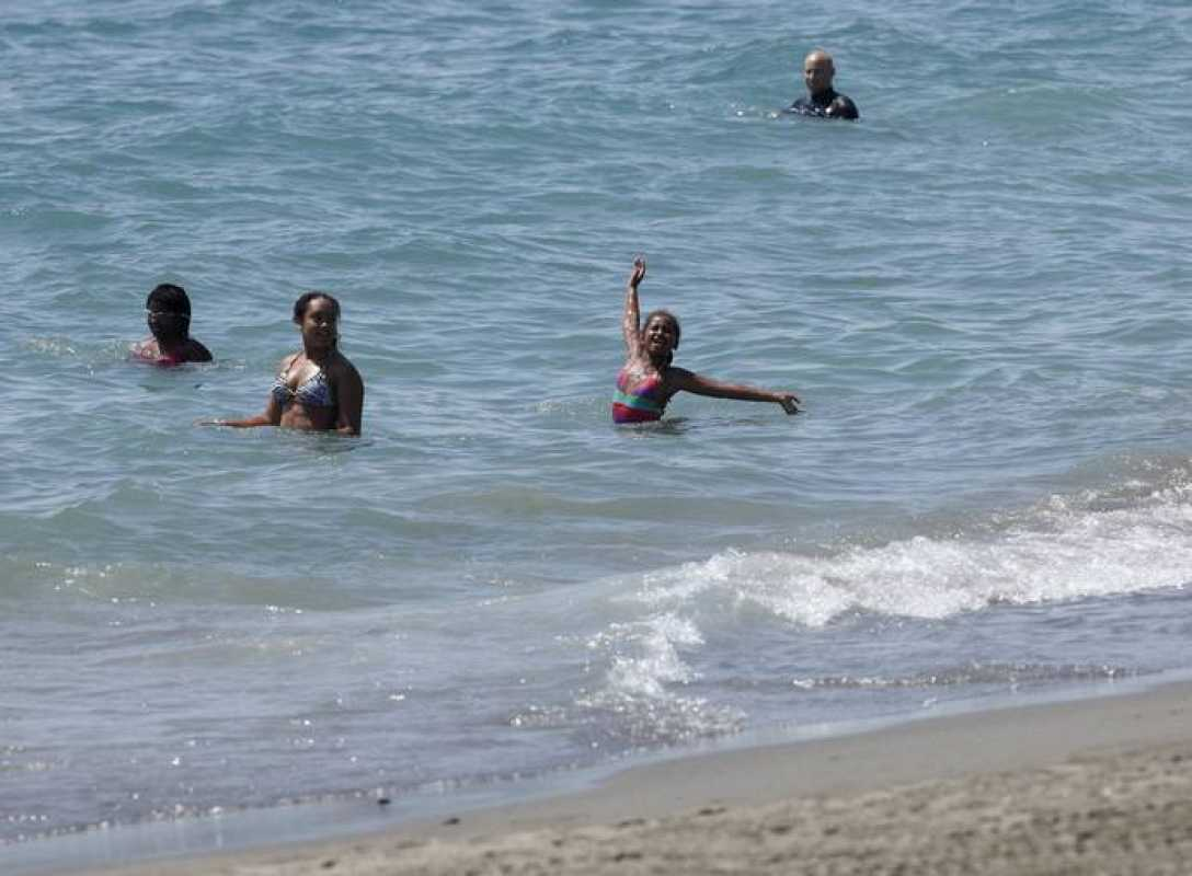 Sasha, daughter of U.S. first lady Michelle Obama, bathes in the Mediterranean Sea in Estepona during their vacation in southern Spain