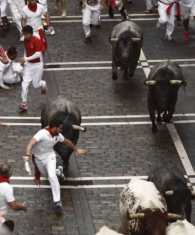 Los mozos corren en Mercaderes